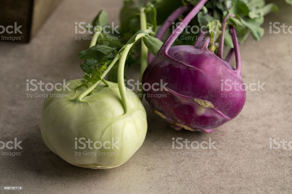 Fresh green and purple kohlrabi stock photo