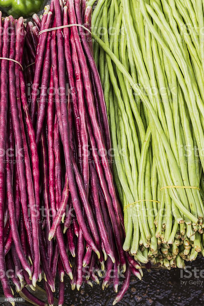 Fresh green and red beans for sale. stock photo