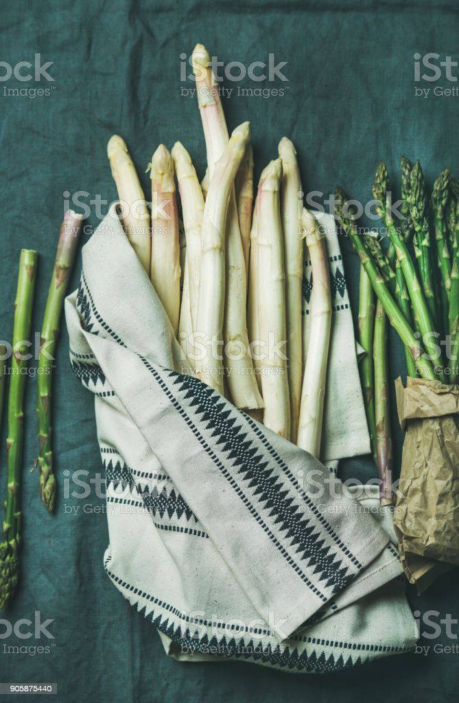 Fresh green and white asparagus in towel, top view royalty-free stock photo