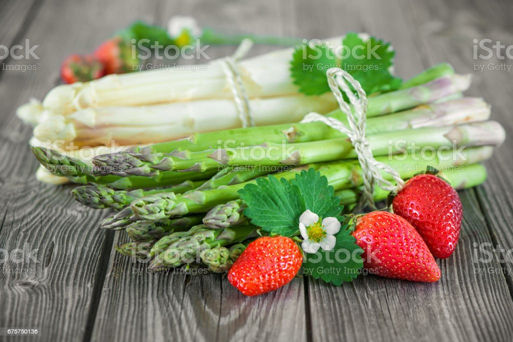 Fresh green and white asparagus stock photo