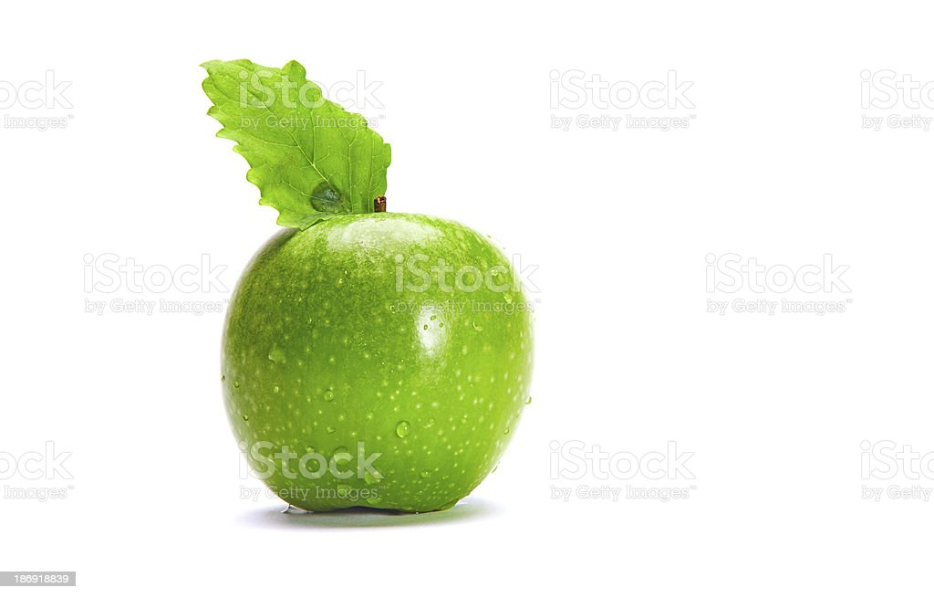 Fresh Green Apple with Leave and Waterdrops royalty-free stock photo