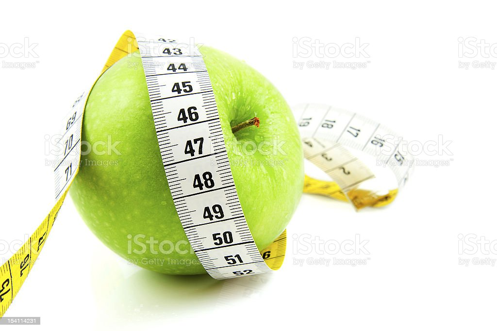 Fresh green apple with measure tape royalty-free stock photo