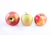 Fresh green apples on a white background. Three green apples on a white background.