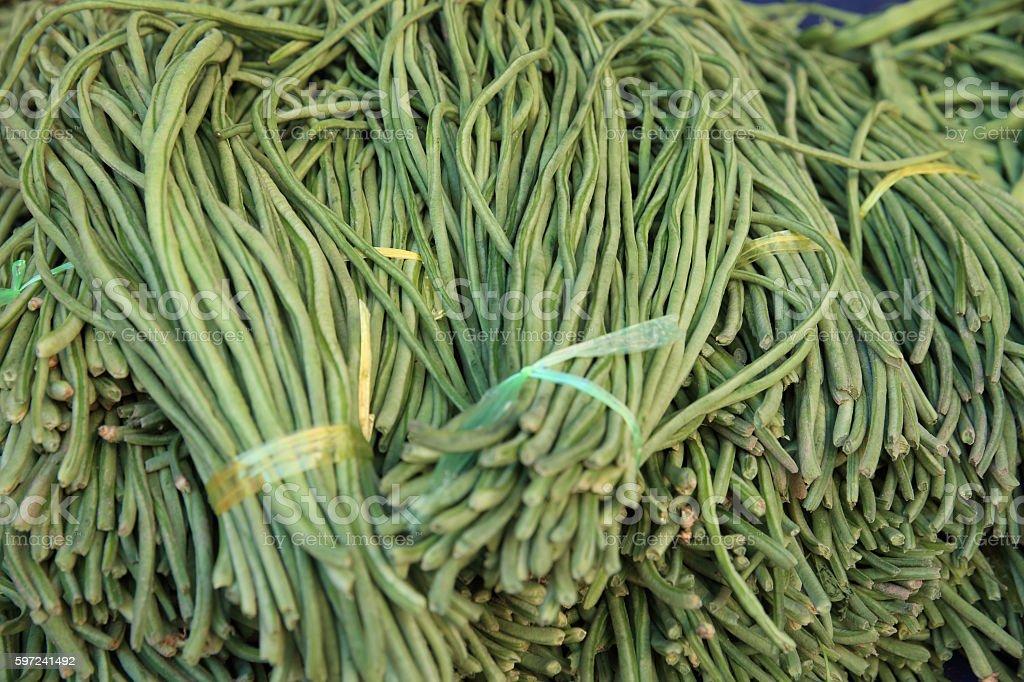 fresh green bean selling on vegetable market stock photo