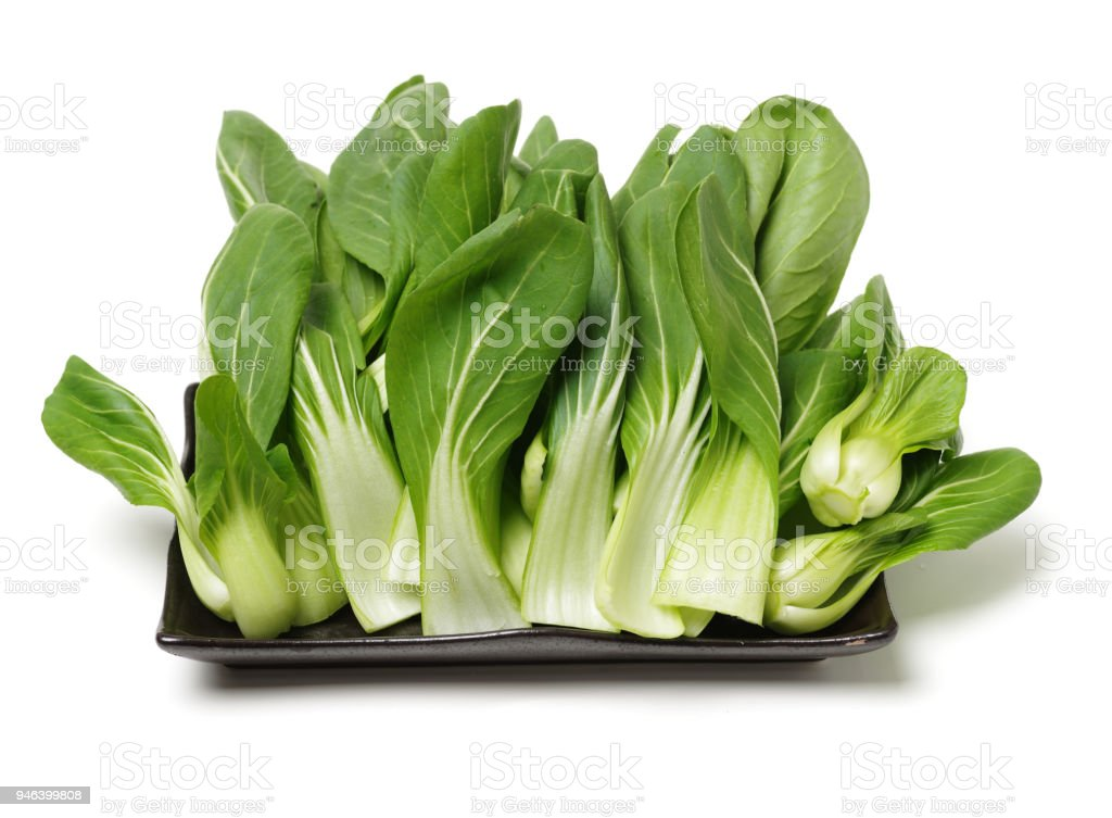 Fresh green bok choy (chinese cabbage) isolated on white background stock photo