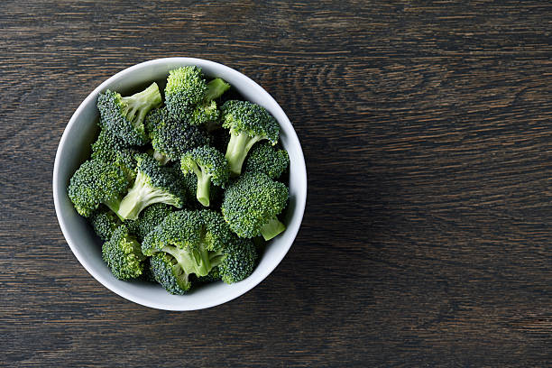 Fresh green broccoli in a bowl stock photo