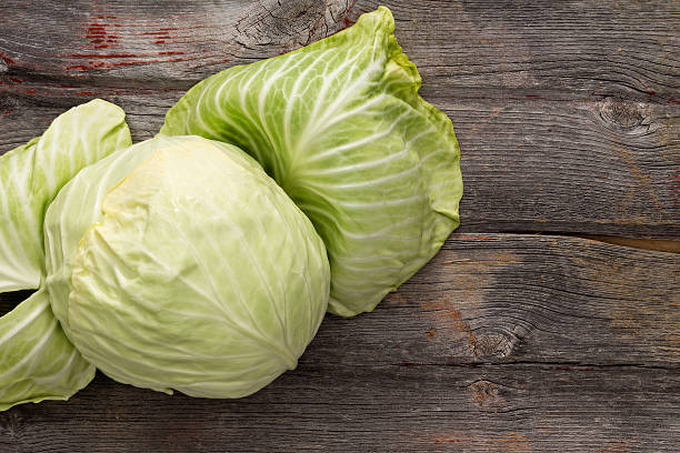 Fresh green cabbage on a wooden table stock photo