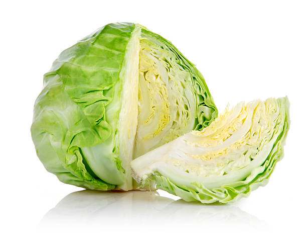 fresh green cabbage with cut - cabbage stock photos and pictures