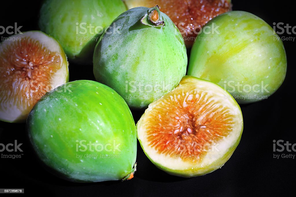 fresh green figs on black background royalty-free stock photo