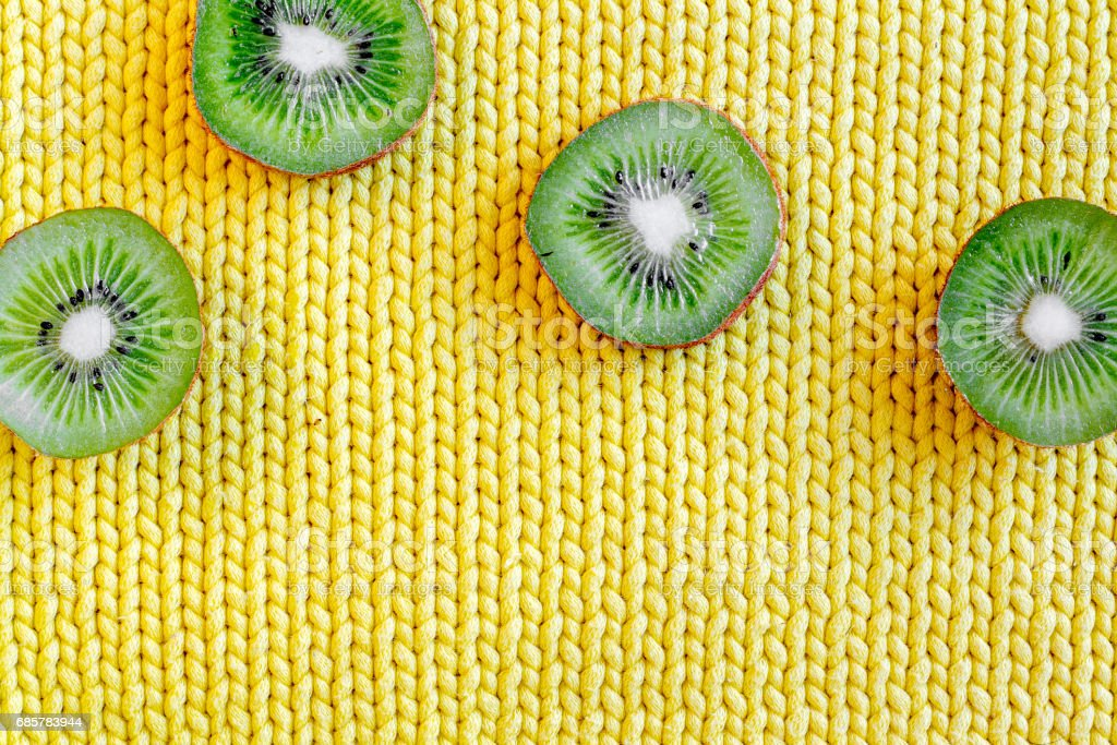 fresh green fruits with kiwi on yellow background top view mock-up royalty-free stock photo