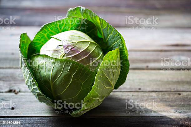Fresh green garden cabbage on rustic wooden background
