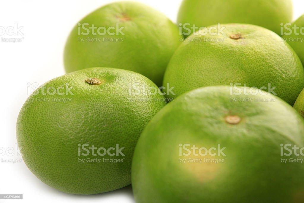 fresh green grapefruits on white background stock photo