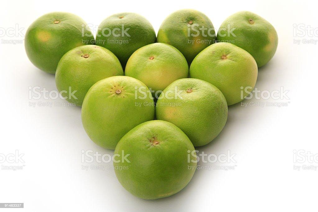 fresh green grapefruits on white background royalty-free stock photo