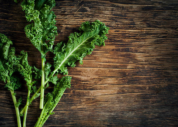 Fresh Green Kale on wooden background stock photo
