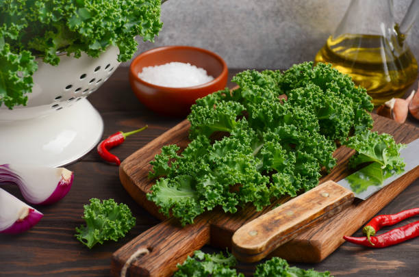 Fresh green kale with olive oil and spices, ready for cooking stock photo
