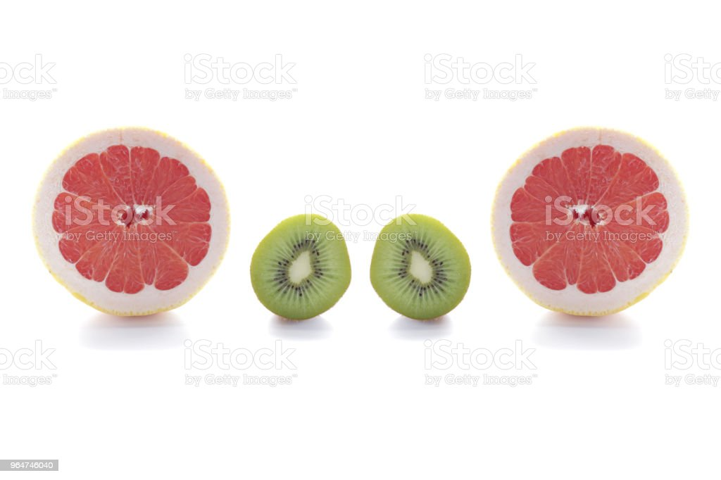 fresh green kiwi fruit and pink grapefruit isolated on white background royalty-free stock photo