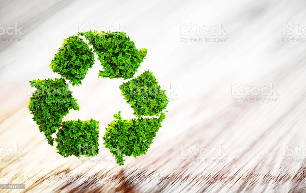 Fresh green leaf recycle symbol on wooden desk with blurred background. 3D illustration. stock photo