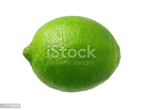 Fresh Green Lime photographed pretty much straight on from a side view.  Lime is a rounded citrus fruit similar to a lemon, but greener, smaller, and with the distinctive acid flavor.  It is grown from an evergreen citrus tree, and is widely cultivated in warm climates.  The subject was photographed with a warm soft box and has highlight in the upper left-hand area.  The lime is a favorite ingredient used by bartenders.  The image is  a cut out, isolated on a white background.