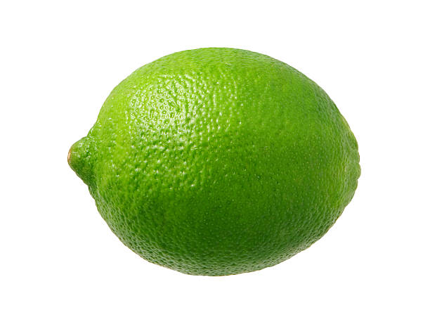 Fresh Green Lime isolated  Fresh Green Lime photographed pretty much straight on from a side view.  Lime is a rounded citrus fruit similar to a lemon, but greener, smaller, and with the distinctive acid flavor.  It is grown from an evergreen citrus tree, and is widely cultivated in warm climates.  The subject was photographed with a warm soft box and has highlight in the upper left-hand area.  The lime is a favorite ingredient used by bartenders.  The image is  a cut out, isolated on a white background. lime stock pictures, royalty-free photos & images