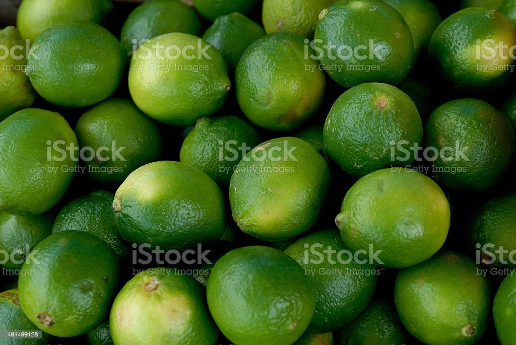 Fresh green limes for sale at farmers market stock photo
