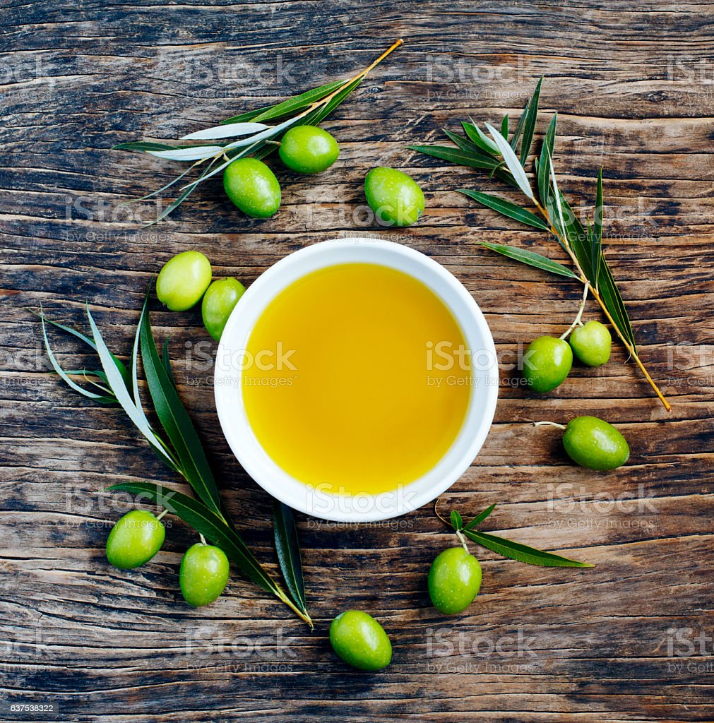 Fresh green olives with leaves and olive oil stock photo