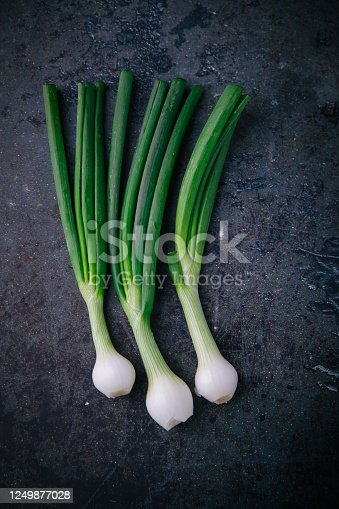 Fresh green onion on the old background. Top view. free space for your text