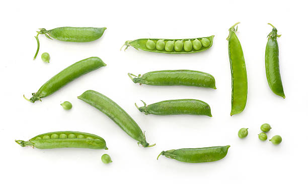 Fresh green pea pods and peas stock photo