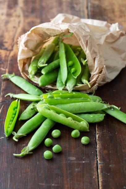 fresh green peas in bag stock photo