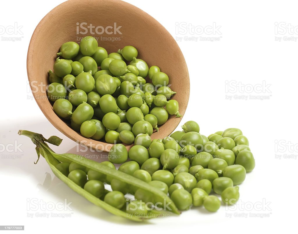Fresh green peas in bowl royalty-free stock photo