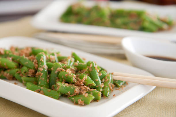 fresh green peas lightly cooked with brans - hot healthy salad, snack, appetiser in asian style. hay diet, vegan, vegetarian food. - appetiser stock photos and pictures