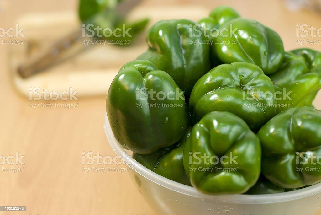 Fresh green pepper in white bowl royalty-free stock photo