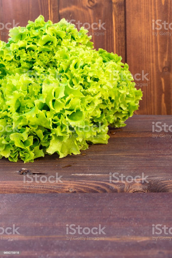 fresh green salad on wooden background royalty-free stock photo