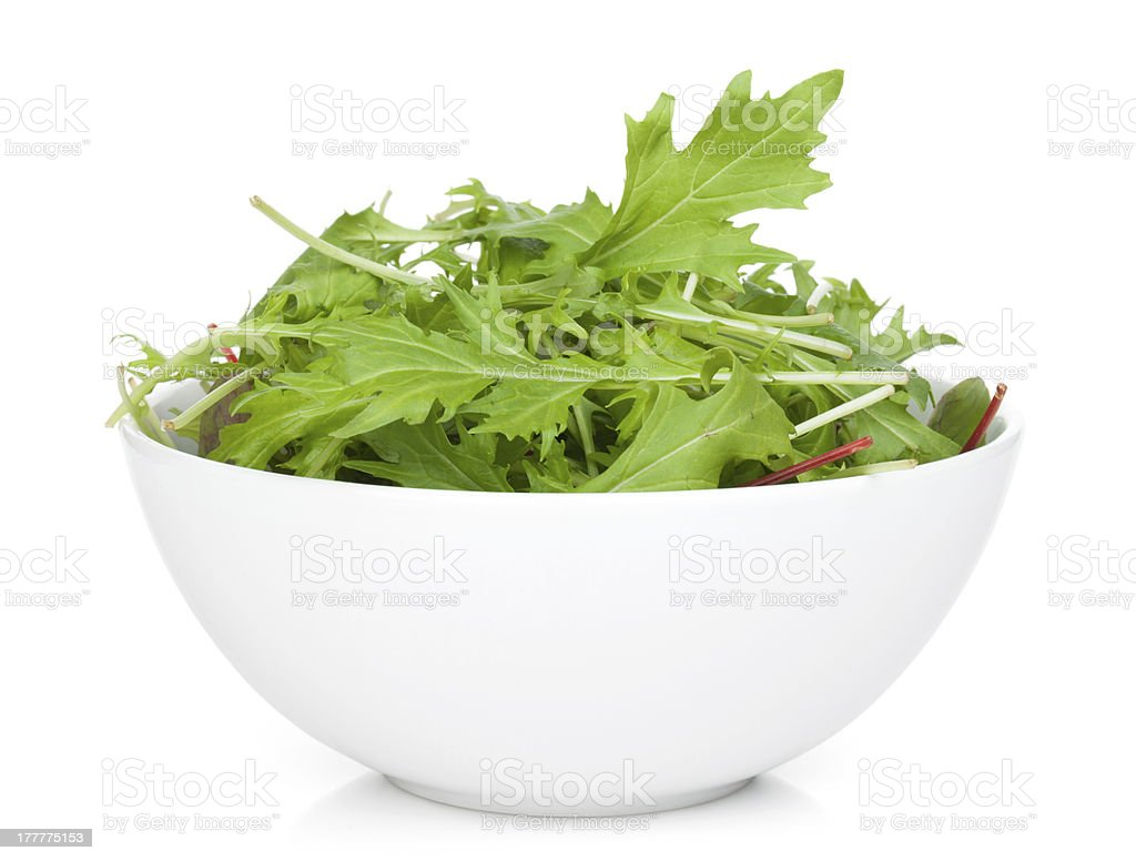 Fresh green salad served in a white bowl stock photo