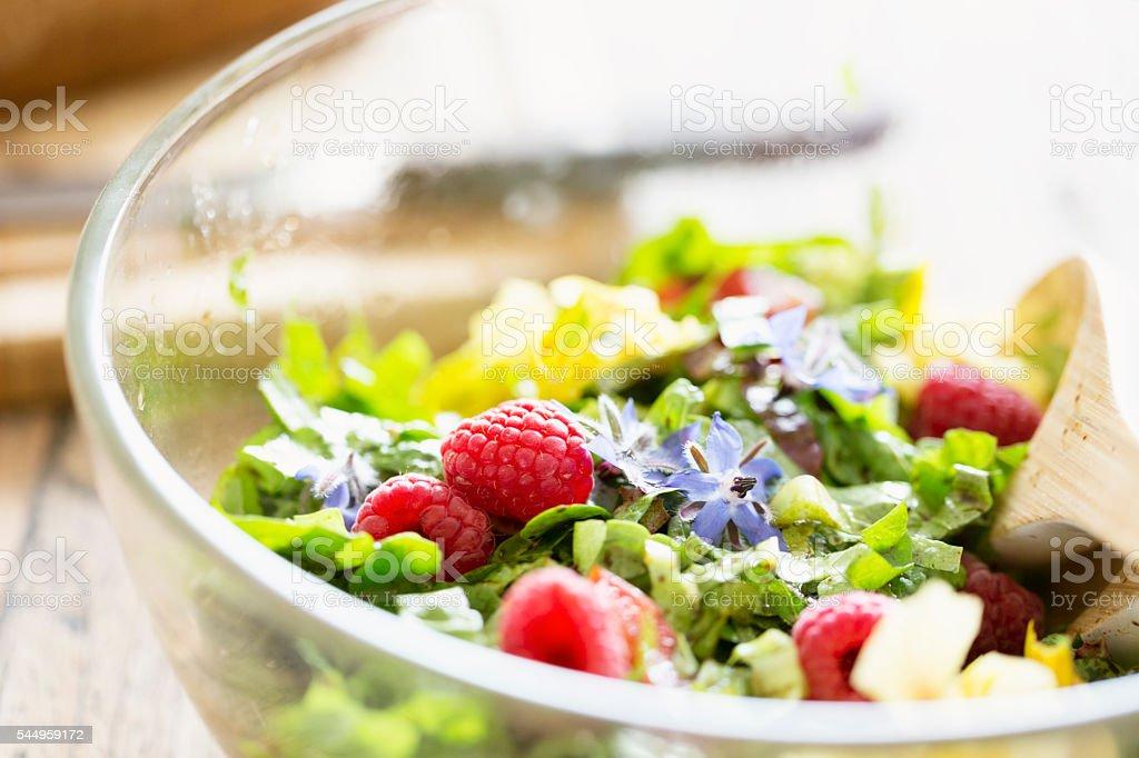 fresh green salad with tomatos, herbs,  flowers of borage, nasturtium stock photo