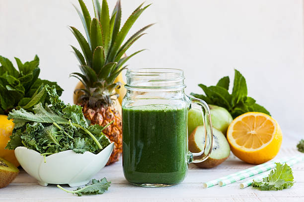 Fresh green smoothie Fresh kale fruit smoothie in a jar with ingredients chlorophyll stock pictures, royalty-free photos & images