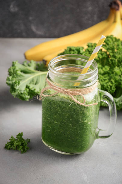 Fresh green smoothie with kale and banana. stock photo