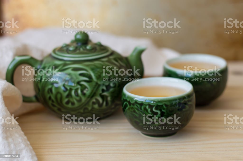 Fresh green tea in two small cups and teapot stock photo