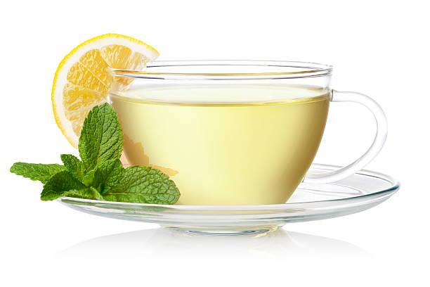 fresh green tee - heiße zitrone stock-fotos und bilder