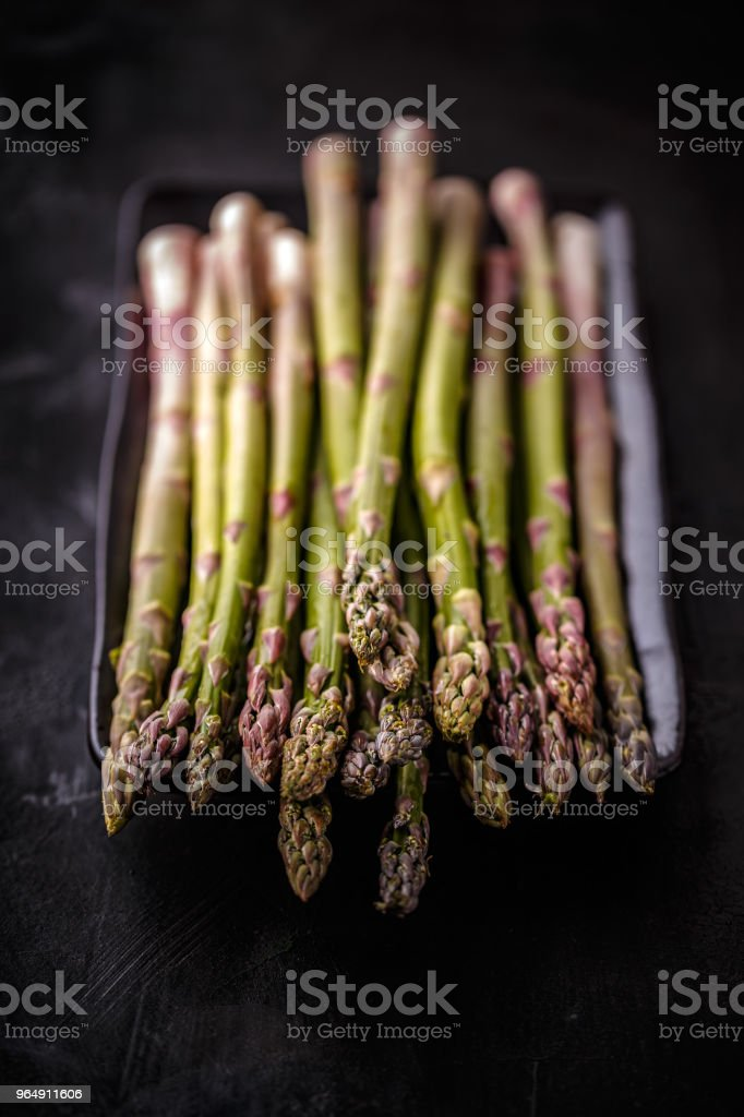 Fresh green uncooked asparagus royalty-free stock photo