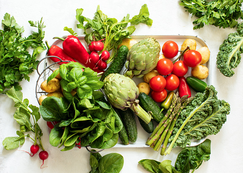Fresh  vegetables in assortment put on a kitchen table, ready for being cooked, top-down view