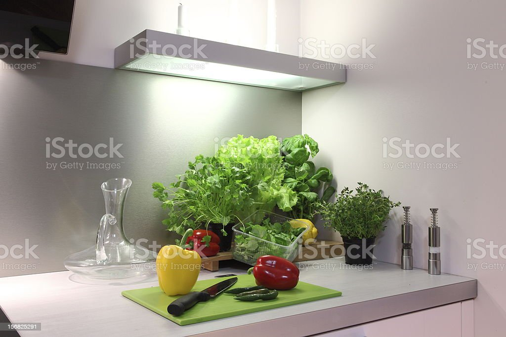 Fresh greens in modern kitchen royalty-free stock photo