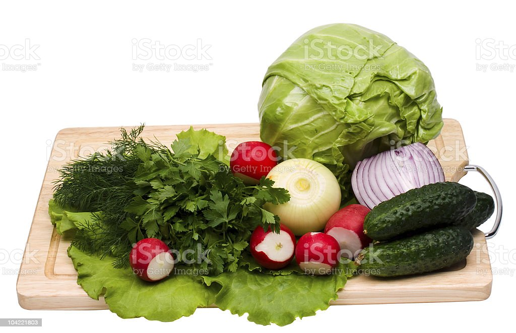 Fresh green-stuffs on cutting board royalty-free stock photo
