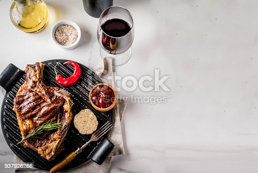 808351132 istock photo Fresh grilled meat beef steak with with red wine, herbs and spices. 937926266