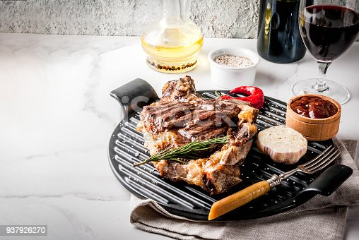 808351132 istock photo Fresh grilled meat beef steak with with red wine, herbs and spices. 937926270