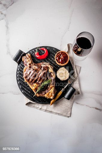 808351132 istock photo Fresh grilled meat beef steak with with red wine, herbs and spices. 937926366