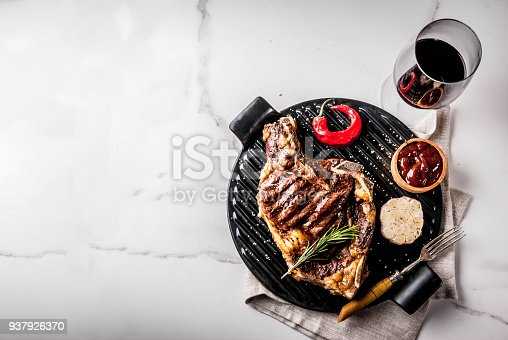 808351132 istock photo Fresh grilled meat beef steak with with red wine, herbs and spices. 937926370