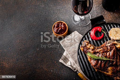 808351132 istock photo Fresh grilled meat beef steak with with red wine, herbs and spices. 937926410