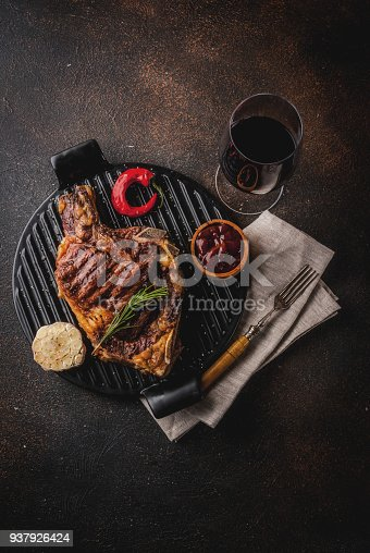 808351132 istock photo Fresh grilled meat beef steak with with red wine, herbs and spices. 937926424