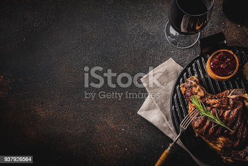 808351132 istock photo Fresh grilled meat beef steak with with red wine, herbs and spices. 937926564