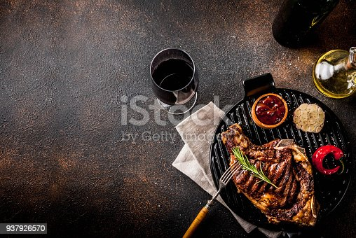 808351132 istock photo Fresh grilled meat beef steak with with red wine, herbs and spices. 937926570